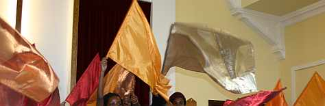 Youngsters worshipping with flags during an all age service